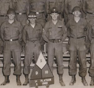 Staff Sergeant Ambrose, left of me on far right this photo